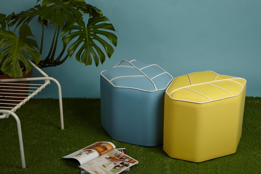 Outdoor poufs in soft colours inspired on the Mediterranean vibe.