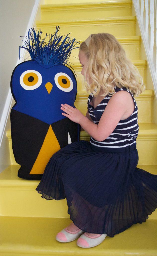 bird cushion with blue raffia